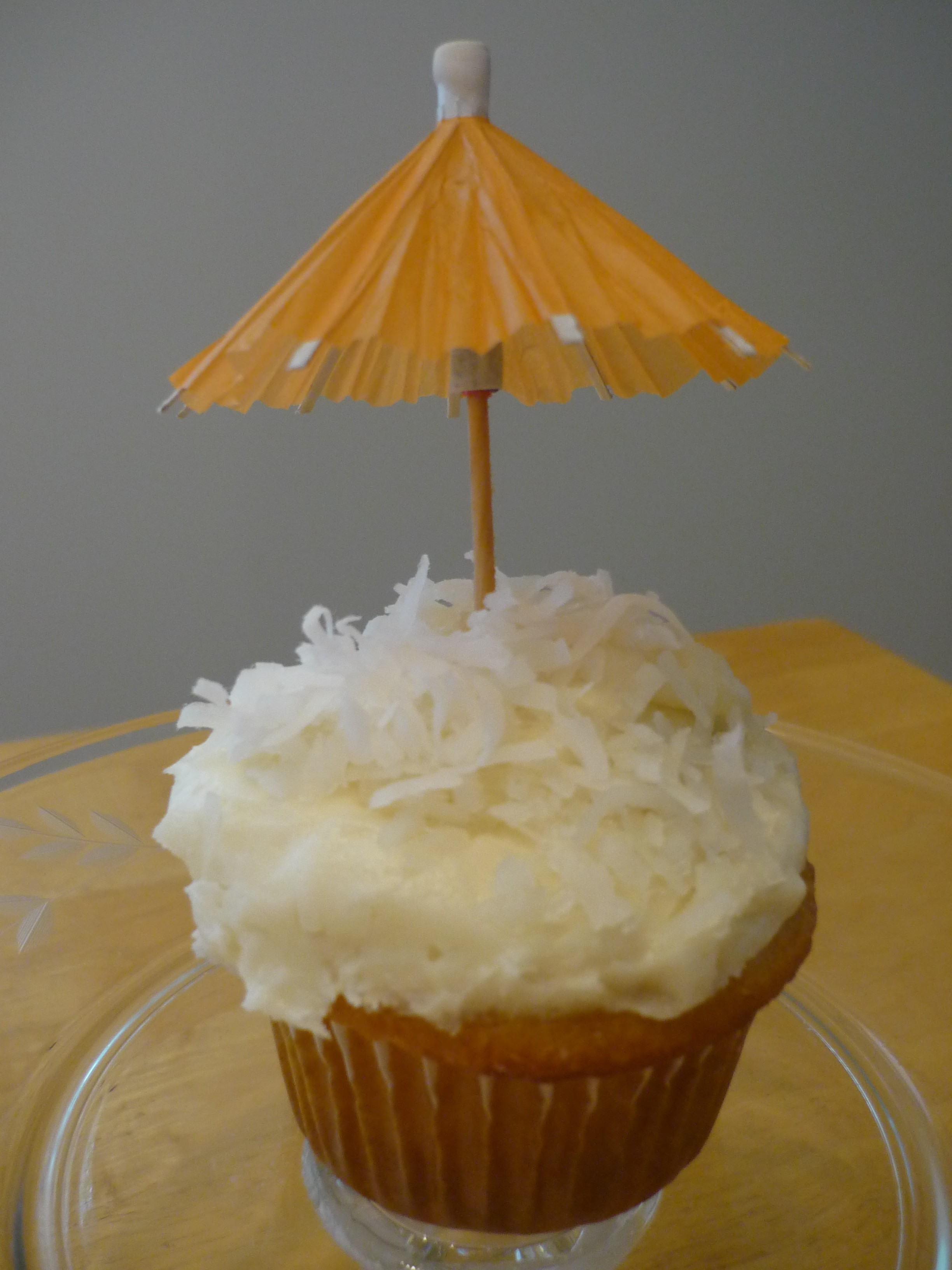 coconut-cupcake-with-coconut-rum-frosting-topped-with-shreded-coconut ...